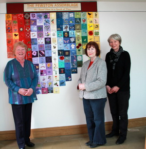 Textile artist Maureen Fackrell of Knaresborough, Washburn Stitcher Liz Carnell of Harrogate and project leader Sally Robinson of Fewston, with the Fewston Assemblage Project panel